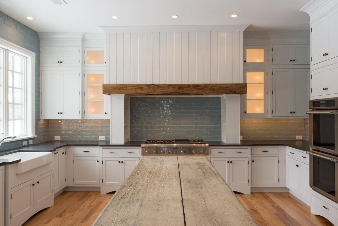 Berwyn Nantucket custom home kitchen with custom tile work and wood island