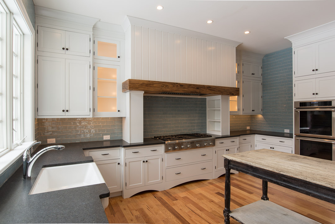 Berwyn Nantucket custom home kitchen with built-in range and hood - american farmhouse interior design