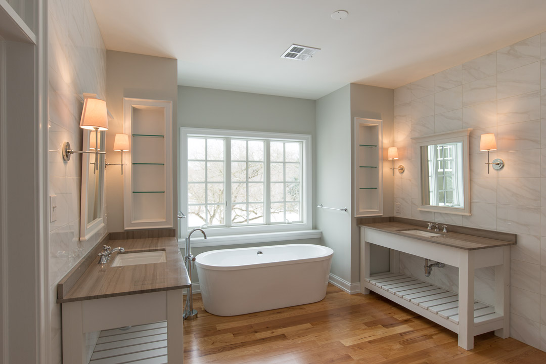 Winslow Interiors - bathroom with dual vanities and marble backsplash