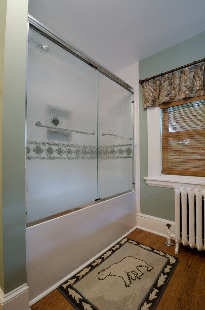 Bryn Mawr bathroom renovation shower enclosure and window treatment