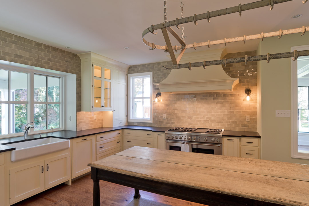 New american farmhouse kitchen featuring custom cabinetry