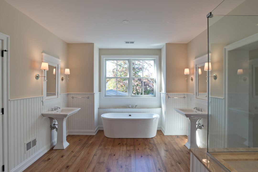 New american farmhouse bathroom with dual sinks and standalone tub