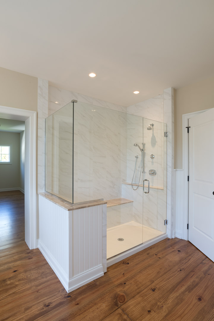 Winslow Interiors -  custom glass and marble shower enclosure