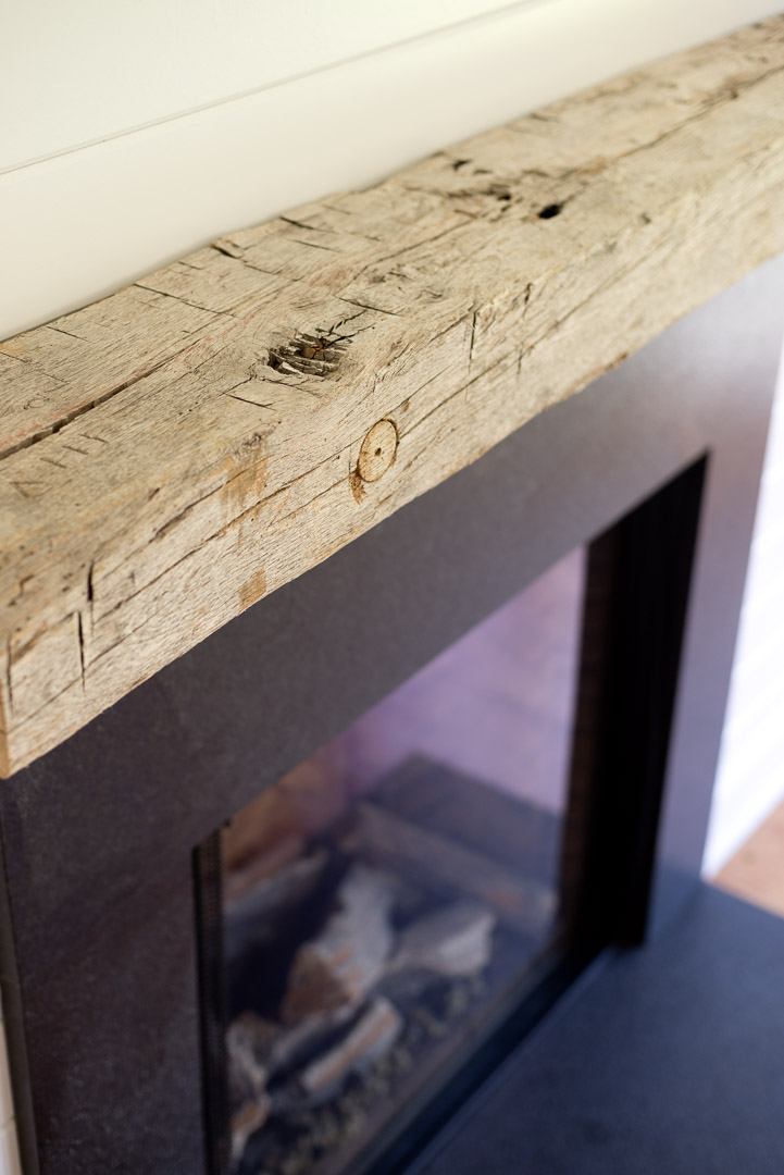 New american farmhouse custom gas fireplace with aged wood mantle