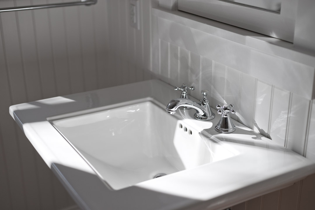 Winslow Interiors - bathroom detail with sink and wainscoting