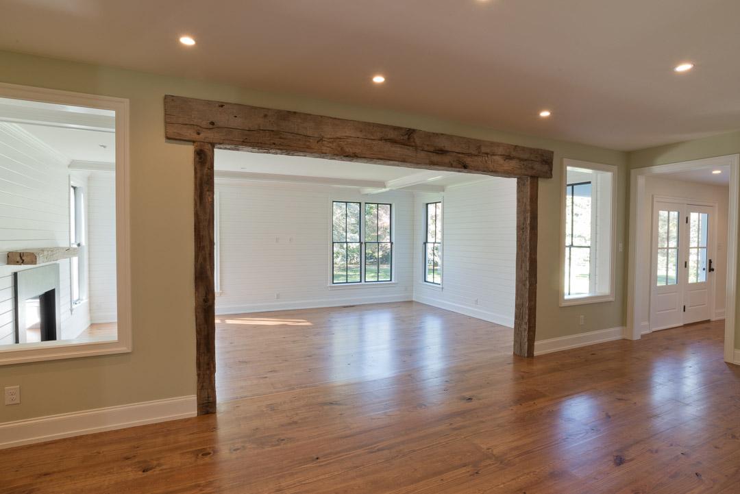 New american farmhouse custom distressed wood great room entrance