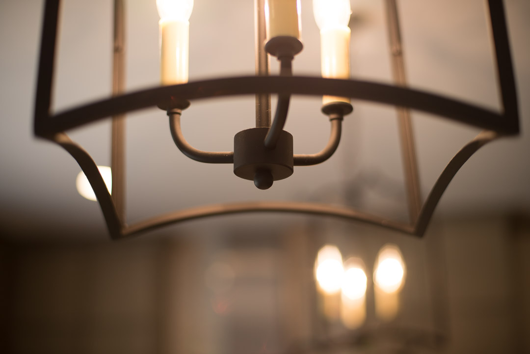 Newtown Square custom home candle style chandelier detail