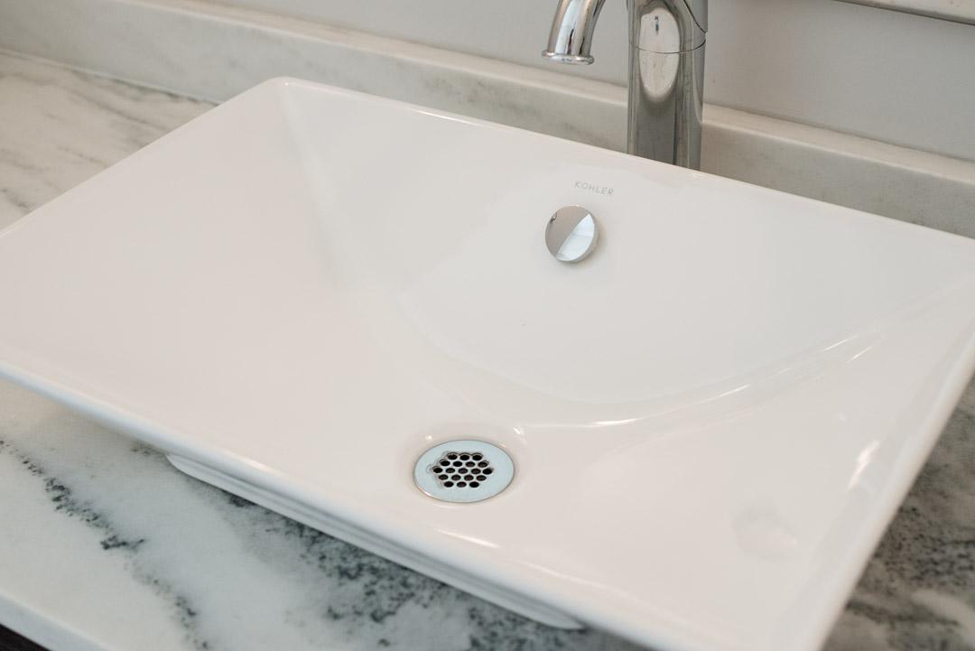 Winslow Interiors Interior Design - vessel sink on top of marble vanity