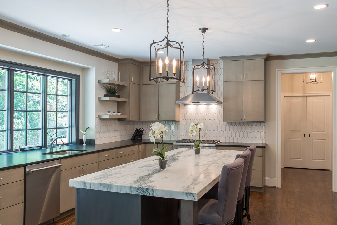 Newtown Square custom home kitchen with granite island and candle style lighting
