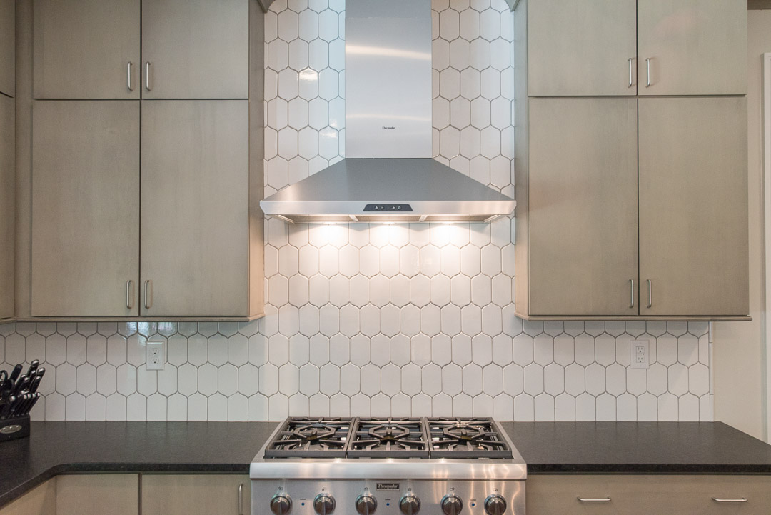 Newtown Square custom home kitchen with built-in range and custom tile backsplash