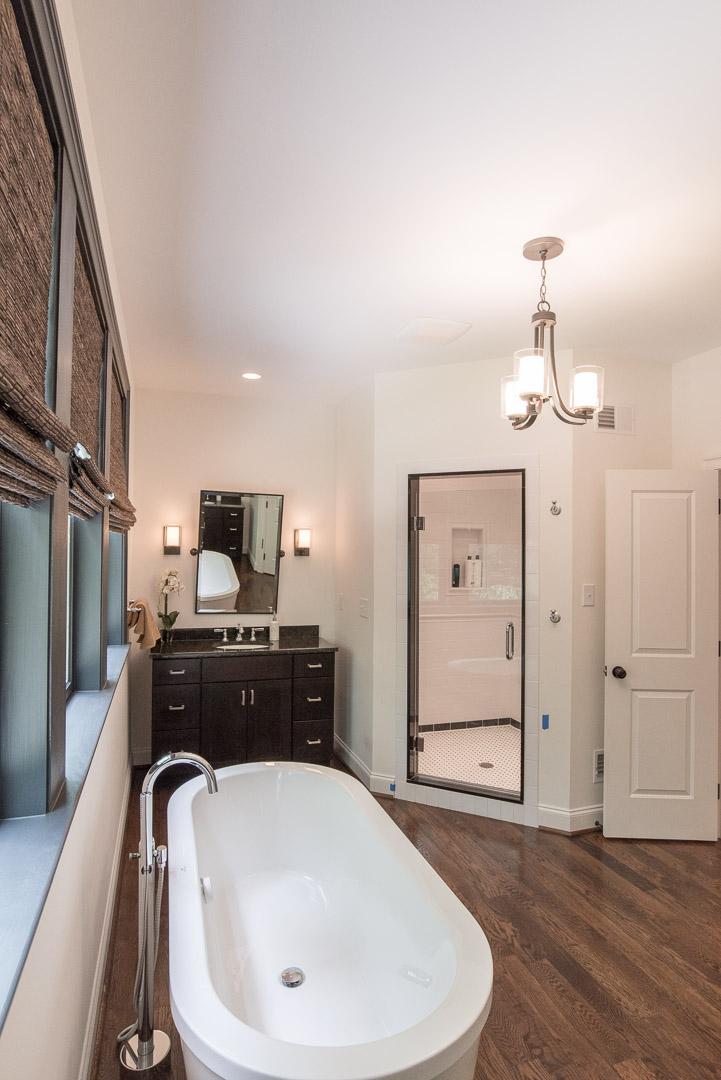 Winslow Interiors Interior Design - bathroom with standalone tub and built-in corner shower enclosure