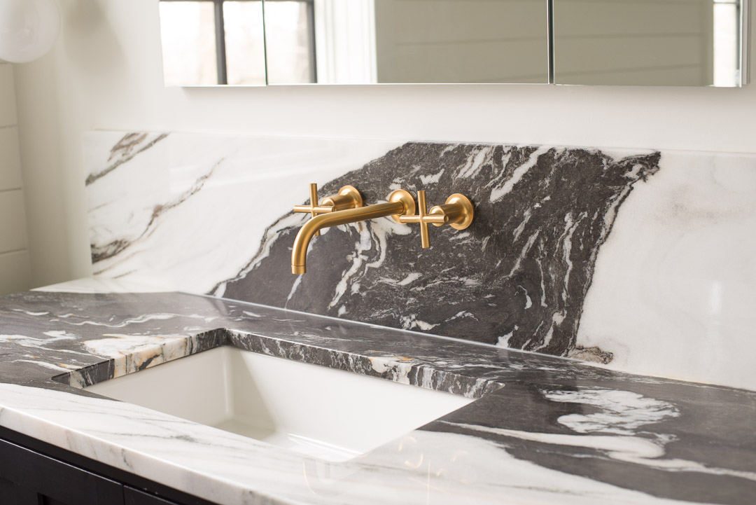 Marble bathroom vanity with brass faucet