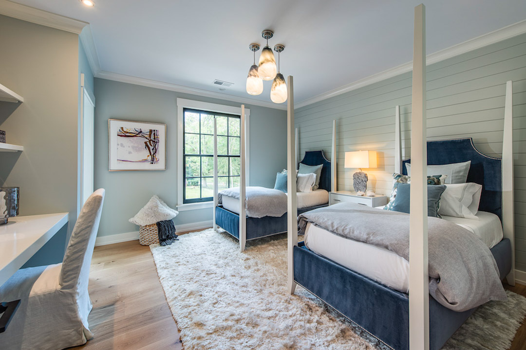 Philadelphia Magazine Design Home 2019 bedroom with wood panel walls and four post beds