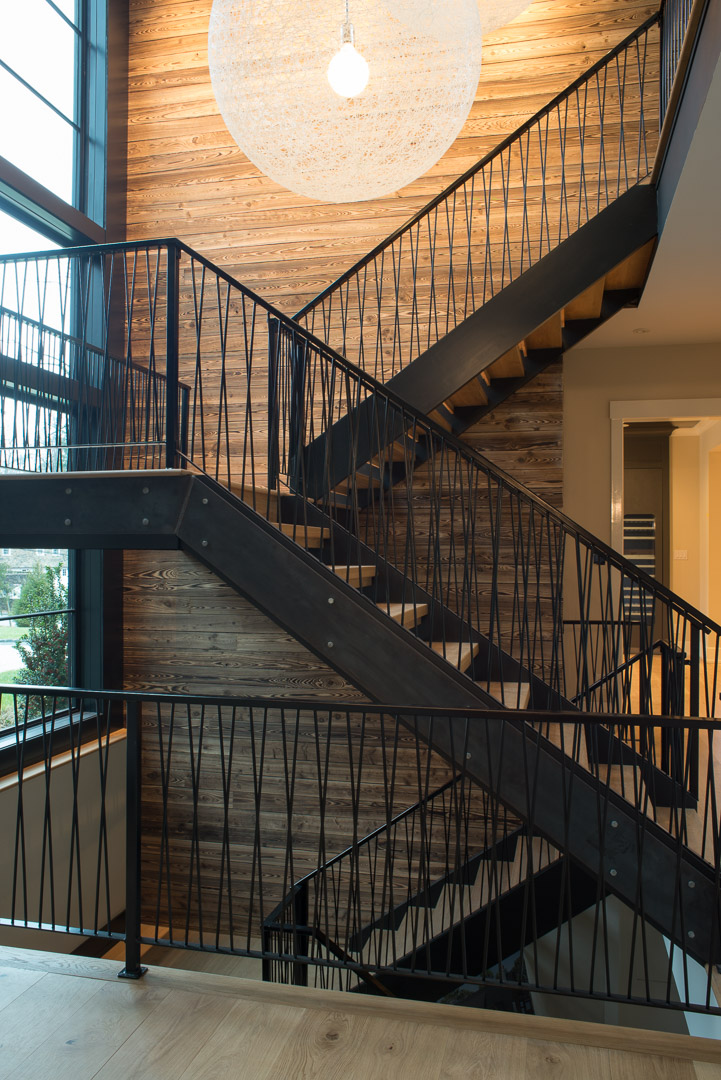 Iron and wood staircase with lighting design