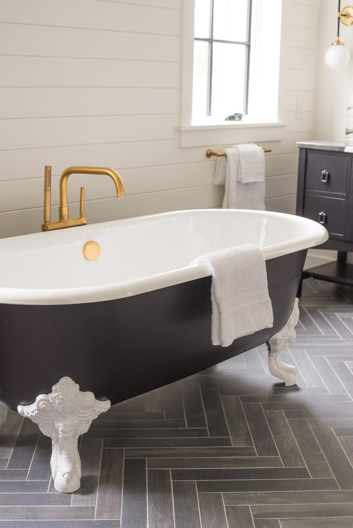 Philadelphia Magazine Design Home 2019 bathroom clawfoot tub and herringbone pattern floor