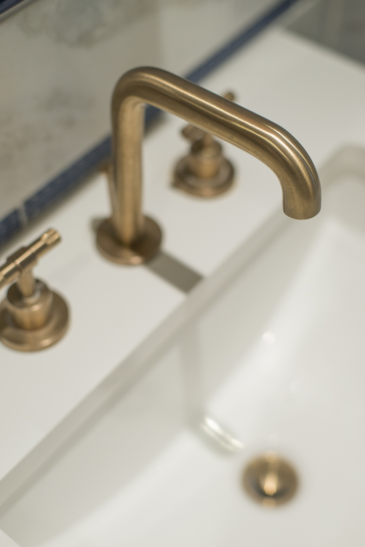 Bryn Mawr Master Bath Renovation brass sink faucet detail with tile backsplash