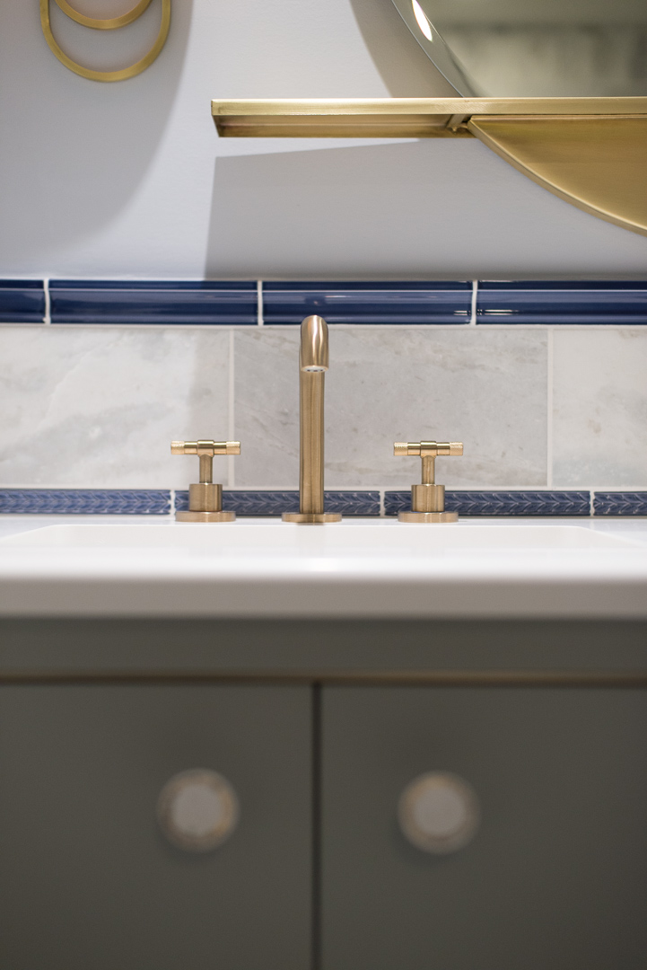 Winslow Interiors - Brass sink faucet with tile backsplash