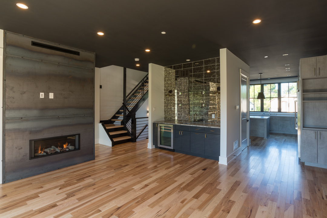 Winslow Interiors -  custom dining room with fireplace and bar with view of kithchen