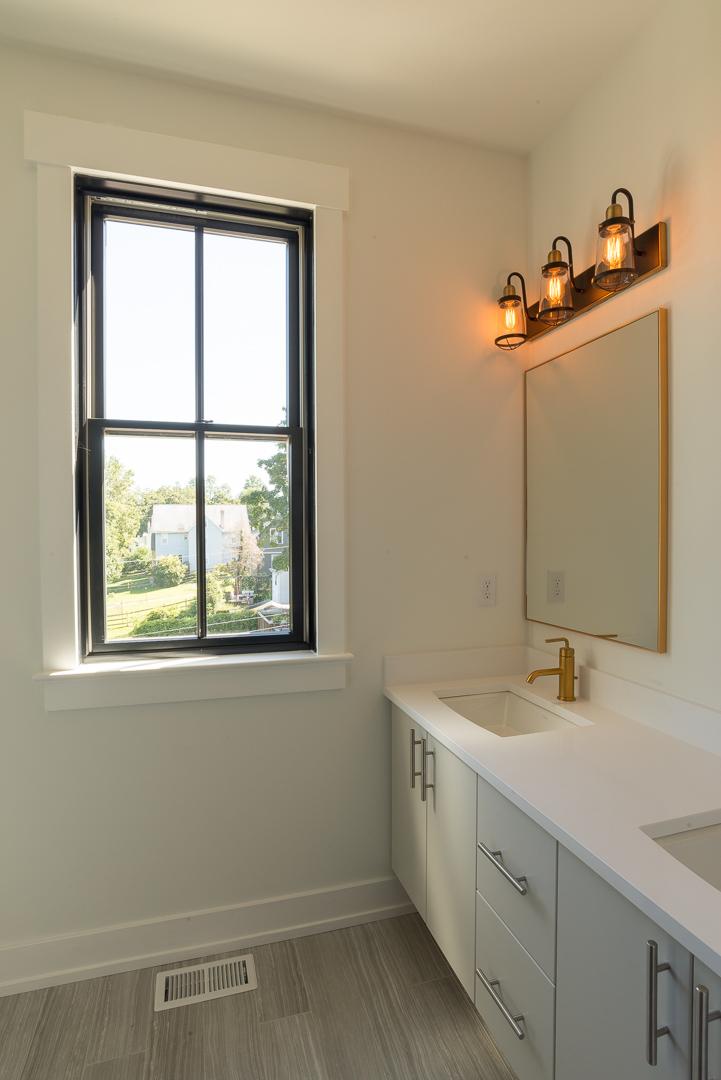 Winslow Interiors - bathroom vanity and lighting