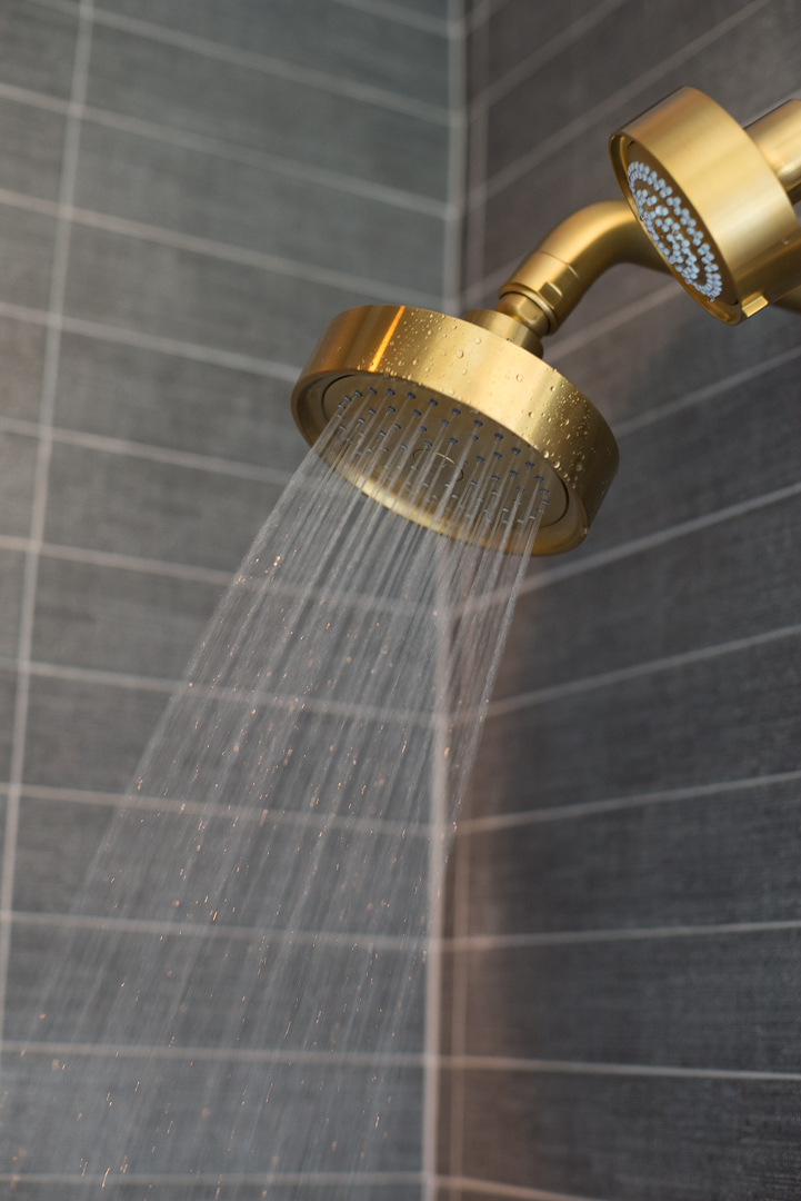 Industrial Chic Townhouses Wayne - contact - custom shower enclosure with brass shower head